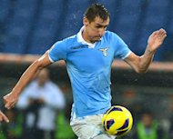 Lazio's Miroslav Klose controls the ball during a Serie A match against AS Roma on November 11, 2012. Klose has proved his injury worries are behind him by equalling the record for the most goals in a Serie A match as he closes in on Gerd Mueller's 38-year-old record for the most goals for Germany