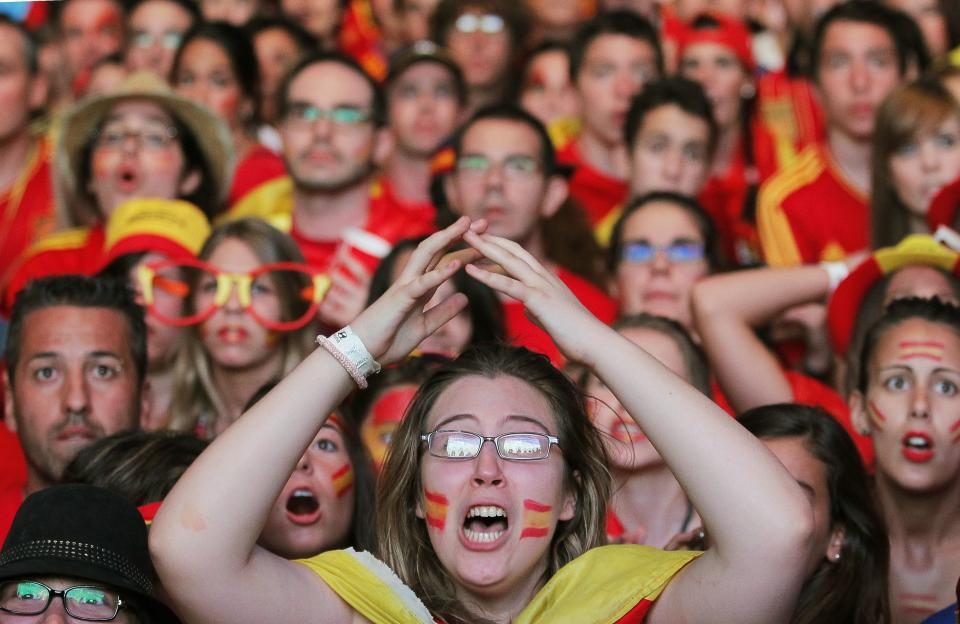 Spanish fans gesture during the viewing of Euro 2012 soccer championship final match between Spain and Italy at the Fan Zone in Madrid, Spain, Sunday, July 1, 2012. (AP Photo/Andres Kudacki)