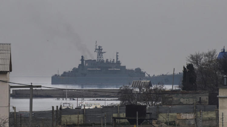 """The Russian naval landing vessel """"Georgiy Pobedonosets"""" enters one of the bays of Sevastopol, Sunday, March 2, 2014. Russian President Vladimir Putin has defied calls from the West to pull back his troops, insisting that Russia has a right to protect its interests and the Russian-speaking population in Crimea and elsewhere in Ukraine.(AP Photo/Andrew Lubimov)"""