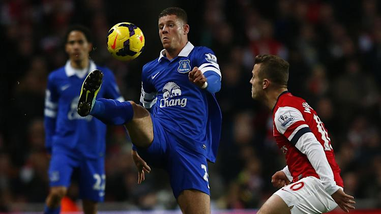 Everton's Barkley clears the ball away from Arsenal's Wilshire during their English Premier League soccer match at The Emirates in London