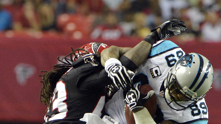 Atlanta Falcons cornerback Dunta Robinson (23) stops Carolina Panthers wide receiver Steve Smith (89) during the first half of an NFL football game Sunday, Sept. 30, 2012, in Atlanta. (AP Photo/Rich Addicks)