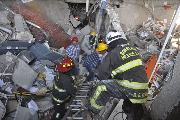 Firefighters belonging to the Tacubaya sector and workers dig for survivors after an explosion at an adjacent building to the executive tower of Mexico's state-owned oil company PEMEX, in Mexico City,