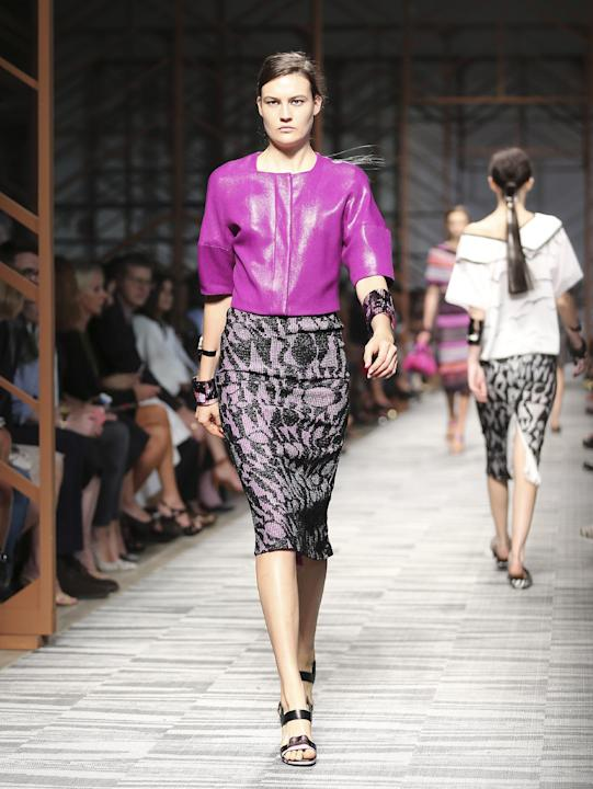 FILE - In this Sept. 22, 2013 file photo, a model wears a creation for Missoni women's Spring-Summer 2014 collection, part of the Milan Fashion Week, unveiled in Milan, Italy. Orchid is growing on