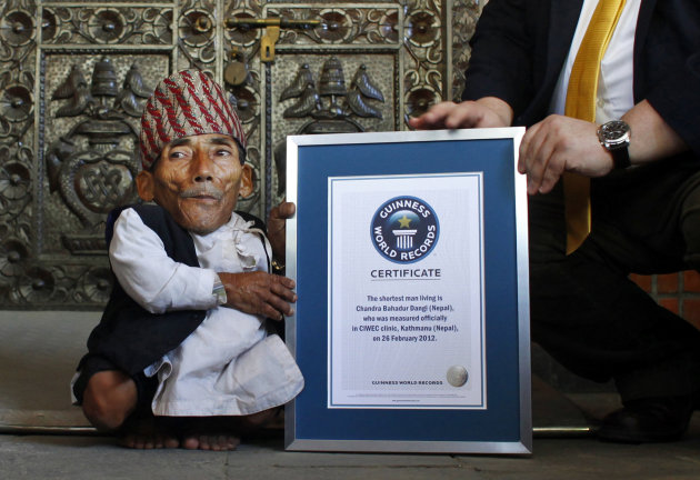 Nepal&#39;s Chandra Bahadur Dangi is given a certificate by Editor-in-Chief of Guinness World Records, Craig Glanday, after being declared the world&#39;s shortest living man and shortest man ever by the Guinness Book of Records, at a ceremony in Katmandu, Nepal, Sunday, Feb. 26, 2012. The 72-year-old man was measured at just 21.5 inches (54.6 centimeters) tall has been declared the shortest person to be recorded by the Guinness World Records snatching the title from Junrey Balawing of the Philippines, who is 23.5 inches (60 centimeters) tall. (AP Photo/Niranjan Shrestha)