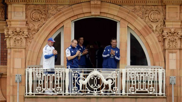 England's coach Andy Flower applauds the players off the field at lunch with fitness coach Huw Bevan, Kevin Pietersen and batting coach Graham Gooch during the first test cricket match against New Zea