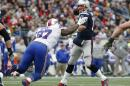 Buffalo Bills defensive tackle Corbin Bryant (97) pressures New England Patriots quarterback Tom Brady, right, in the first half of an NFL football game Sunday, Dec. 28, 2014, in Foxborough, Mass. (AP Photo/Elise Amendola)