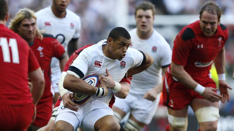 England's Burrell runs through the Wales defence during their Six Nations international rugby union match at Twickenham in London