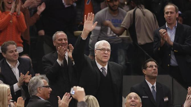 Phil Jackson waves to the crowd as he is introduced during the first half of an NBA basketball game between the New York Knicks and the Indiana Pacers at Madison Square Garden on Wednesday, March 19, 2014, in New York. Jackson was hired as the president of the Knicks this week