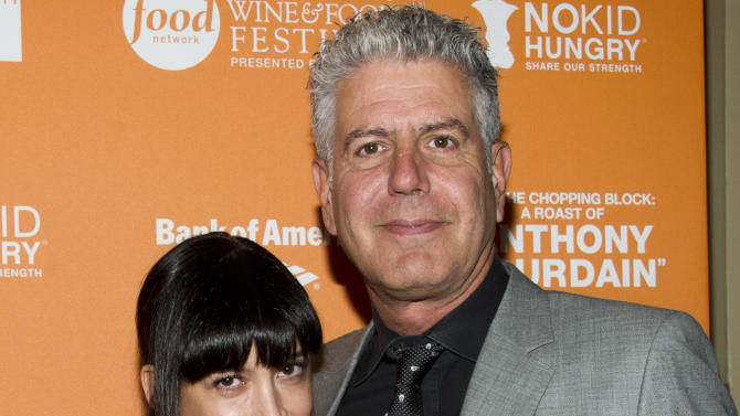 """Anthony Bourdain and Ottavia Busia attend """"On The Chopping Block: A Roast of Anthony Bourdain"""" on Thursday, Oct. 11, 2012 in New York. (Photo by Charles Sykes/Invision/AP Images)"""