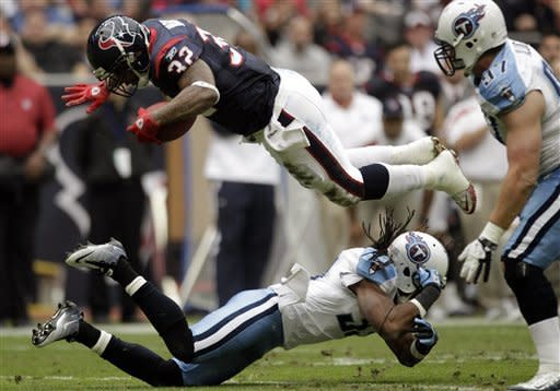 Titans edge Texans 23-22, await playoff fate