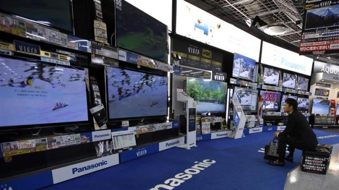 File photo of a man looking at Panasonic Corp's Viera televisions displayed at an electronics store in Tokyo