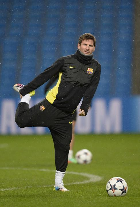 Barcelona's Messi stretches during a training session at the Etihad Stadium in Manchester