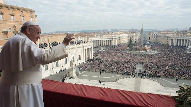 """In this picture provided by the Vatican newspaper L'Osservatore Romano, Pope Francis delivers his """"Urbi et Orbi"""" (to the city and to the world) blessing from the central balcony of St. Peter's Basilica at the Vatican, Thursday, Dec. 25, 2014. Tens of thousands of Romans and tourists in St. Peter's Square listened as the pontiff delivered the Catholic church's traditional """"Urbi et Orbi"""" (Latin for """"to the city and to the world) Christmas message from the central balcony of St. Peter's Basilica. Francis said: """"truly there are so many tears this Christmas."""" Pope Francis focused his concern Thursday on those weeping in the world this Christmas, singling out refugees, hostages and others suffering in the Middle East, Africa and Ukraine as he prayed for hope and peace. (AP Photo/L'Osservatore Romano)"""