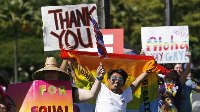 Colin Porter waves a flag with other supporters of same-sex marriage as they celebrate while the Hawaii State Senate convenes to approve the bill to legalize same-sex marriage in the state of Hawaii, in Honolulu