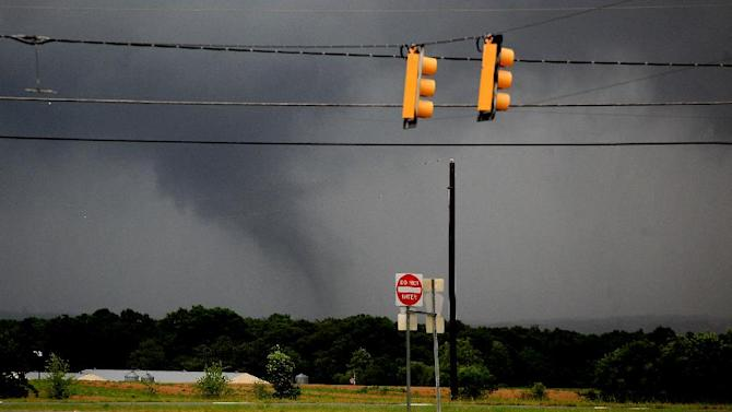 A funnel cloud appears in the distance in Level Plains, Ala., near U.S. Highway 84 and Dale County Road 1, Sunday, June 10, 2012. The area was under a tornado warning until 12:15 p.m. There is no official word of any injuries. (AP Photo/Dothan Eagle, Max Oden)