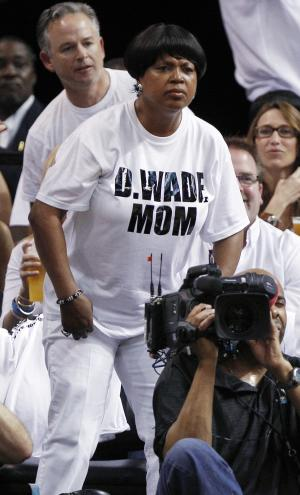 FILE - In this June 9, 2012, file photo, Jolinda Wade, Dwyane Wade's mother, watches during the first half of Game 7 of the NBA basketball playoffs Eastern Conference finals between the Miami Heat and the Boston Celtics, in Miami. The season started with 30 teams, got whittled down to 16 and now there are two _ the Miami Heat and Oklahoma City Thunder, set to begin the NBA finals on Tuesday night. (AP Photo/Lynne Sladky, File)