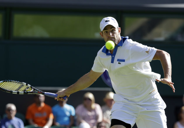 Andy Roddick of the United States plays a return to David Ferrer of Spain during a third round men's singles match at the All England Lawn Tennis Championships at Wimbledon, England, Saturday, June 30