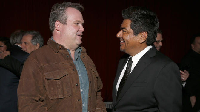 Eric Stonestreet and George Lopez attend a Celebration of LA's Music Industry at the Getty House on Thursday, Feb. 7, 2013 in Los Angeles. (Photo by Todd Williamson/Invision/AP)