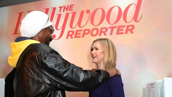 Snoop Dogg AKA Snoop Lion, left, and Julia Stiles attend The Hollywood Reporter Nominees' Night Insider at Spago on Monday, Feb. 4, 2013, in Beverly Hills, Calif. (Photo by Casey Rodgers/Invision for The Hollywood Reporter/AP Images)