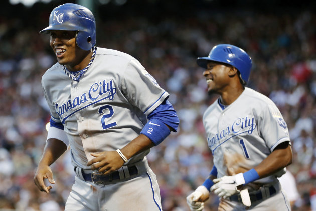 Kansas City Royals&#39; Alcides Escobar (2) and Jarrod Dyson (1) head to the dugout after scoring on a two-run double by Alex Gordon in the first inning of a baseball game against the Boston Red Sox in Boston, Saturday, Aug. 25, 2012. (AP Photo/Michael Dwyer)