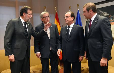 (L-R) Spanish Prime Minister Mariano Rajoy Brey, European Commission President Jean-Claude Juncker, French President  Francois Hollande and Portuguese Prime Minister Pedro Passos Coelho meet European Union leaders summit in Brussels