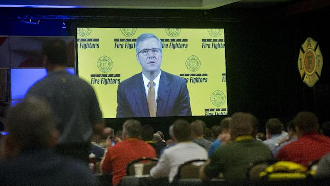 Former Florida Gov. Jeb Bush, is seen on a projection screen during his pre-recorded speech at the International Association of Firefighters (IAFF) Presidential Forum in Washington, Tuesday, March 10, 2015. (AP Photo/Pablo Martinez Monsivais)