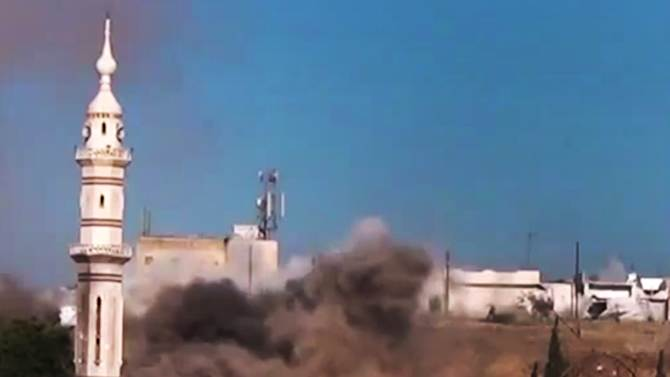In this image made from amateur video released by the Ugarit News and accessed Monday, July 2, 2012, black smoke leaps the air from shelling near a mosque in Talbiseh, the central province of Homs, Syria. The head of the Arab League urged Syria's exiled opposition to unite Monday, saying they must not squander the opportunity to overcome their differences as Western efforts to force President Bashar Assad from power all but collapse. (AP Photo/Ugarit News via AP video) TV OUT, THE ASSOCIATED PRESS CANNOT INDEPENDENTLY VERIFY THE CONTENT, DATE, LOCATION OR AUTHENTICITY OF THIS MATERIAL