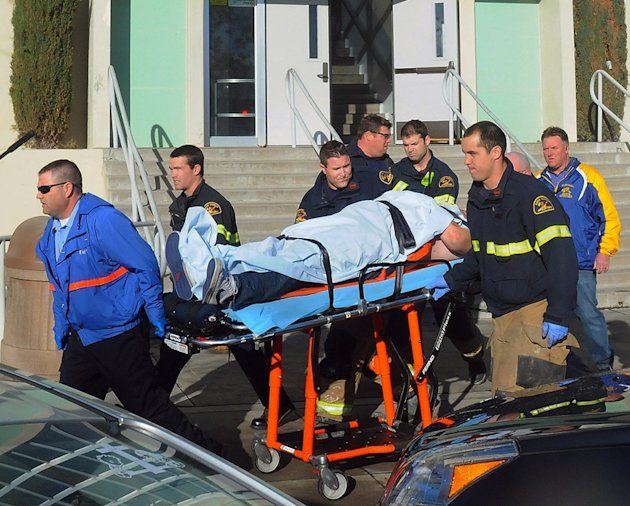 This image provided by the Taft Midway Driller/Doug Keeler shows paramedics transporting a student wounded during a shooting Thursday Jan. 10, 2013 at San Joaquin Valley high school in Taft, Calif. Au