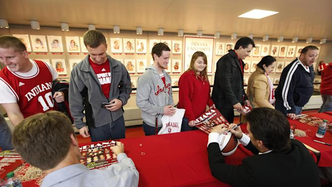 Former Indiana player Steve Alford, right, and Steve Eyl sign autographs for fans before an NCAA college basketball game between Indiana and Stetson on Sunday, Dec. 4, 2011, in Bloomington, Ind.  The 1987 NCAA championship team was to be honored at halftime. (AP Photo/Darron Cummings)