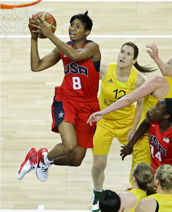 United States' Angel McCoughtry, left, sails to the basket past Australia's Belinda Snell (12) during a women's basketball semifinal game at the 2012 Summer Olympics, Thursday, Aug. 9, 2012, in London