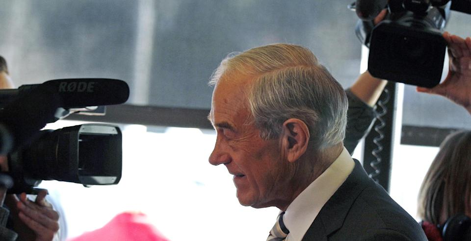 Republican presidential candidate Rep. Ron Paul, R-Texas, is surrounded by cameras while campaigning during lunchtime in Plaistow, N.H., Tuesday Dec. 20, 2011. (AP Photo/Charles Krupa)