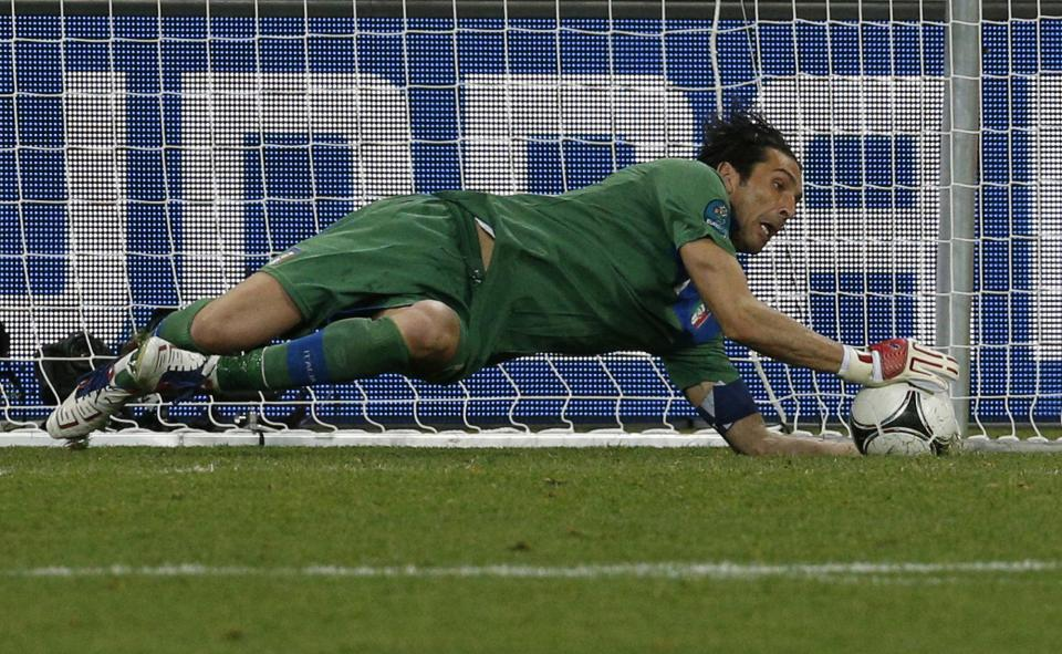 Italy goalkeeper Gianluigi Buffon makes a save in the penalty shootout during the Euro 2012 soccer championship quarterfinal match between England and Italy in Kiev, Ukraine, Monday, June 25, 2012. (AP Photo/Michael Sohn)