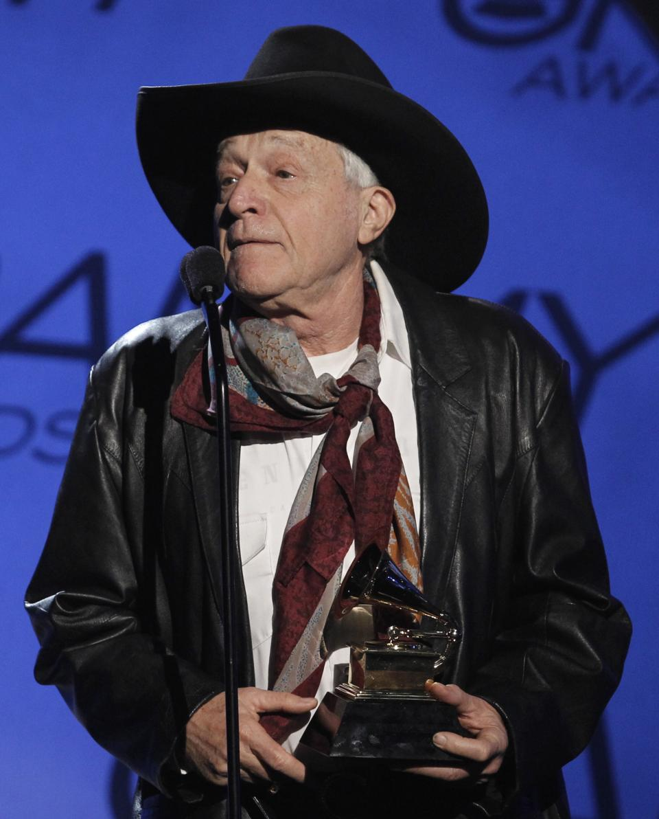 "FILE - In this Sunday, Jan. 31, 2010 file photo, Ramblin' Jack Elliott accepts the award for traditional blues album for ""A Stranger Here"" at the Grammy Awards in Los Angeles. The revitalized Newport Folk Festival continues to expand as younger fans discover old folk stars like Elliott. (AP Photo/Matt Sayles, File)"
