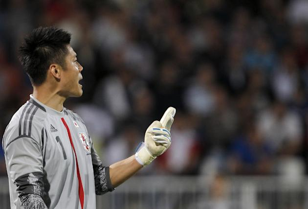 Japan's goalkeeper Eiji Kawashima gestures during a friendly soccer match between Serbia and Japan, at Karadjordje stadium in Novi Sad, Serbia, Friday, Oct. 11, 2013
