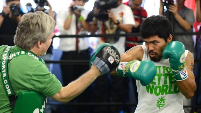 Freddie Roach (L) And Manny Pacquiao (R) Of The Philippines Take A Media Workout At Wild Card Boxing Club On May 30,  AFP/Getty Images