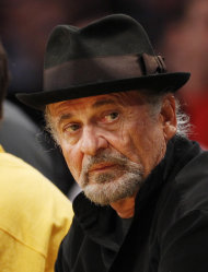 FILE - In this March 23, 2012 file photo, actor Joe Pesci sits court-side at the NBA basketball game between the Portland Trail Blazers and Los Angeles Lakers, in Los Angeles. An attorney for Pesci said Monday Feb. 4, 2013, that the Oscar-winning actor had settled a $3 million lawsuit against the makers of a planned biopic on the Gotti crime family for undisclosed terms. (AP Photo/Danny Moloshok, File)