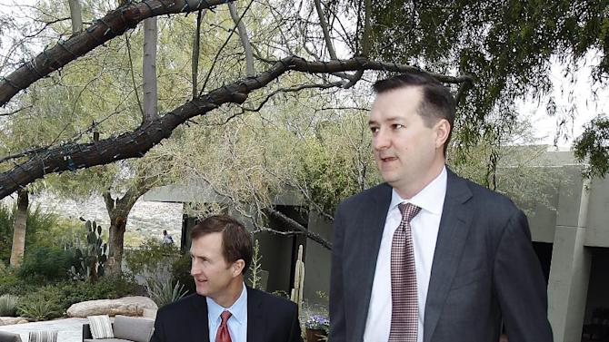 Chicago Cubs President of Buiness Operations Crane Kenney, left, and Chairman Tom Ricketts, right, leave following a meeting with team owners, Thursday, Jan. 12, 2012, in Paradise Valley, Ariz. (AP Photo/Paul Connors)