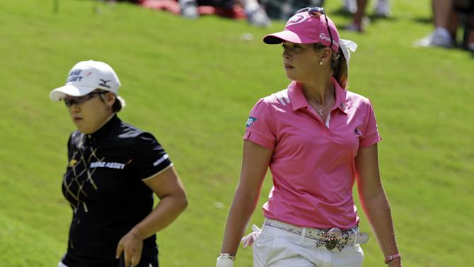 Paula Creamer, right, and Jiyai Shin, of South Korea, watch play on the eighth green during the Kingsmill Championship LPGA Tour golf tournament in Williamsburg, Va., Sunday, Sept. 9, 2012. (AP Photo/Steve Helber)
