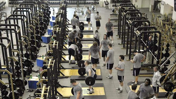 In this 2010 photo, Notre Dame football players work out in the weight room at the Guglielmino Athletics Complex on the campus of the University of Notre Dame in South Bend, Ind. (AP Photo/Joe Raymond)