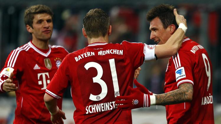 Munich players celebrate during their German first division Bundesliga soccer match against Leverkusen in Munich