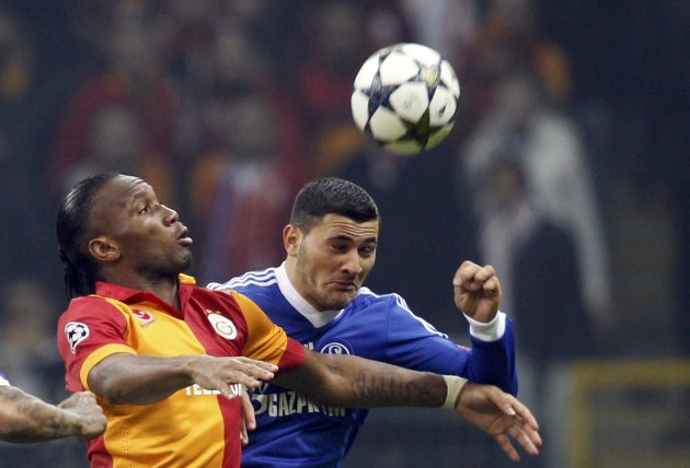 Galatasaray's Drogba is challenged by Schalke 04's Kolasinac during their Champions League soccer match in Istanbul