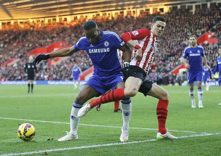 Florin Gardos of Southampton challenges Didier Drogba of Chelsea during their English Premier League soccer match at St Mary's Stadium in Southampton