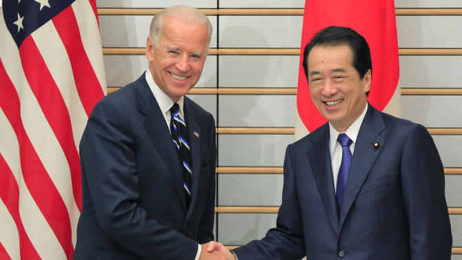 U.S. Vice President Joe Biden, left, is greeted by Japanese Prime Minister Naoto Kan prior to their meeting at Kan's official residence in Tokyo Tuesday, Aug. 23, 2011. (AP Photo/Itsuo Inouye)