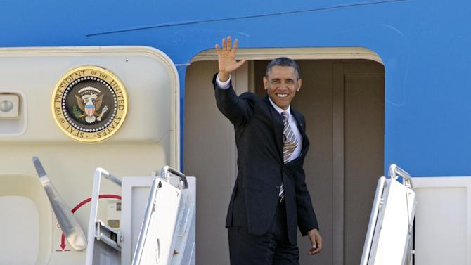 President Barack Obama waves prior to boarding Air Force One before departing from Andrews Air Force Base, Md., Friday, March 29,  2013. Obama is traveling to Miami to promote a plan to create jobs by attracting private investment in highways and other public works. ( AP Photo/Jose Luis Magana)
