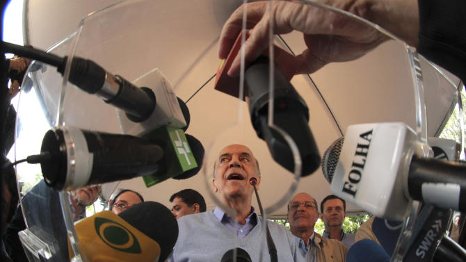 Jose Serra, center, Brazil's presidential candidate for the Social Democracy Party, PSDB, accompanied by relatives and members of his party, speaks during a press conference after voting at a polling station during general elections in Sao Paulo, Brazil, Sunday, Oct. 3, 2010. Serra, 68, former mayor of Sao Paulo, was defeated by outgoing Brazil's President Luiz Inacio Lula da Silva in the 2002 election. (AP Photo/ Thiago Bernardes)
