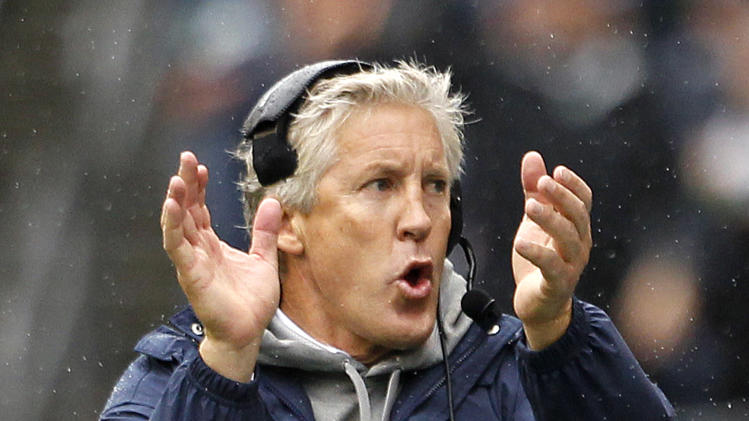 Seattle Seahawks head coach Pete Carroll applauds from the sidelines against the New England Patriots in the first half of an NFL football game, Sunday, Oct. 14, 2012, in Seattle. (AP Photo/Elaine Thompson)