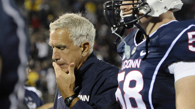 FILE - In this Sept. 21, 2013 file photo, Connecticut head coach Paul Pasqualoni reacts at the end a 24-21 loss to Michigan in an NCAA college football game at Rentschler Field in East Hartford, Conn. Paqualoni was fired Monday, Sept. 30, 2013, after the Huskies lost the first four games of the season. (AP Photo/Jessica Hill, File)