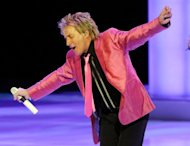 "File picture shows veteran singer Rod Stewart performing in Las Vegas, Nevada last year. Stewart said Saturday he was ""devastated"" that a dose of the flu would prevent him attending his old group's induction into the Rock and Roll Hall of Fame this weekend"