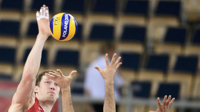 Russia's Muserskiy spikes the ball against Iran's Marouflakrani and Mahdavi during their match at the FIVB Volleyball Men's World Championship Poland 2014 at Atlas Arena  in Lodz
