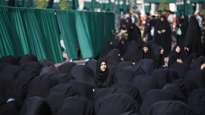 Shiite Muslims pray at the Imam Moussa al-Kadhim shrine during the festival of AShoura in Baghdad, Iraq,Saturday, Nov 24, 2012. The festival of Ashoura commemorates the martyrdom of Imam Hussein, the grandson of Prophet Muhammad at the Battle of Karbala, Iraq, in the year A.D. 680. (AP Photo/Karim Kadim)